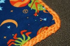 Tutorial on how to add a fabric back to a crochet blanket. SWEET!