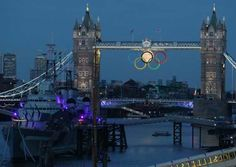 Olympic Rings and a full moon on the London Bridge - August 3, 2012.