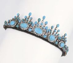 ANTIQUE TURQUOISE AND DIAMOND TIARA/NECKLACE Designed as five graduated oval-shaped turquoise and old-cut diamond clusters to the turquoise and diamond rays, detaches to form a necklace, mounted in silver and gold, circa 1860, approximately 51 cm. long, in original Frazer & Haws brown leather fitted case, 31 Regent St Piccadilly
