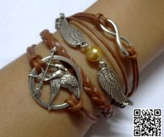 Hey, I found this really awesome Etsy listing at http://www.etsy.com/listing/157722858/hunger-game-birds-infinity-charm