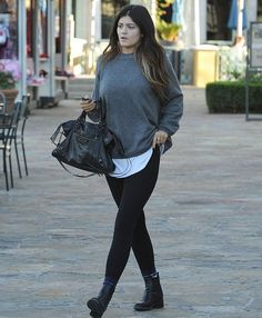 Kylie Jenner wearing Balenciaga City Bag In Black Chanel Pull-On Leather Chelsea Boots