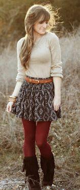 tan/beige top, cognac brown belt, black print skirt, burgundy red tights, brown boots