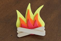 Pinning this campfire * neckerchief slide for later! What a fun slide to do for the campfire program or for any outdoor themed event. It has a PDF you print and use as a guide to cut out the sets of flames. Super easy and very cute! All the info on how to make it is here. AkelasCouncil.blogspot.com