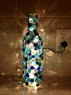 Image 4 of 17 from gallery of Cool DIY Bottle Lamp Ideas To Add Unique Home Decor. This diy glass bead wine bottle lamp is can add glowing effect to any room Glass Bottle Crafts, Wine Bottle Art, Lighted Wine Bottles, Decorating Wine Bottles, Crafts With Bottles, Glass Bead Crafts, Bead Bottle, Glass Beads, Crafts With Glass Bottles