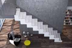 Up to JOY! White choice with glass transparence and calacatta marble. JOY is a stair from the Executive Stars Collection.