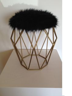 The Black Beauty  This fabulous stool screams Hollywood Glam! Its like a little black dress with gold accessories for your space. With its soft