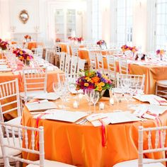 this orange isn't the right shade, but coral linen with white place-settings
