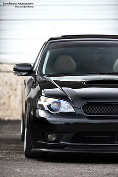 This is what I want to do with my car now. I always wanted to just lower it and throw a CBE on, but now I want the grill and front lip. Sweet ass LGT wagon!!!