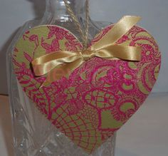 Pretty decoupage heart hanging decoration in a stunning cerise and gold print.. available at www.facebook.com/Aleycrafts
