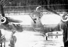 Evil face fighter Me 410 A-1/U 2 with a 50 mm cigarillo in his teeth