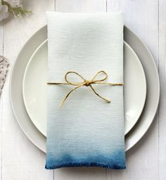 A set of rustic 100% natural linen napkins in a delicate cobalt blue ombre, a subtle frayed edge secured with silk stitching. Carefully hand-cut, hand-dyed and handmade in the Cotswolds. Dinner / table napkins, 47 x 47cm approx - NOW SOLD OUT Cocktail napkins, 16 x 16 cm approx. Available in packs of either 2, 4 or 6 when in stock. Cocktail napkins are perfect for canopies, placing under glasses, or adding a touch of colour as a decoration on top of a plate. Dinner Napkins are g...
