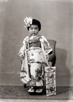 """Vintage portraits of Japanese children holding traditional """"Thousand Year Candy"""" for the Shichi-Go-San Festival, circa 1940s"""