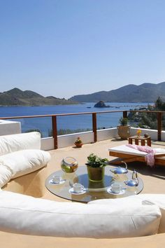 The veranda overlooks the sparkling Aegean Sea. #Jetsetter