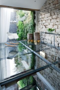 glass floor + dining area beneath + raw masonry wall + green wall behind + hexagonal tiles on floor below ~via ivory-coastlines.tumblr.com guawa:  aleua:  This is amazing  fave pic on tumblr