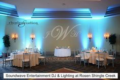 Teal blue LED Lighting, Custom Monogram, and Pinspot on Cake and Newlywed Table at Rosen Shingle Creek Orlando by Soundwave Entertainment, djsoundwave.net.  Photo by Rhodes Studios