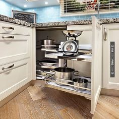 Wow! - slide out corner kitchen shelves. great use of corner space. | CHECK OUT MORE KITCHEN CABINET IDEAS AT DECOPINS.COM | #kitchencabinets #kitchen #cabinet #kitchencabinet #kitchencabinets #kitchenstorage #pantry #pantries #storage #antiquecabinet #bluecabinet #purplecabinet #pinkcabinet #blackcabinet #whitecabinet #redcabinet #greencabinet #yellowcabinet