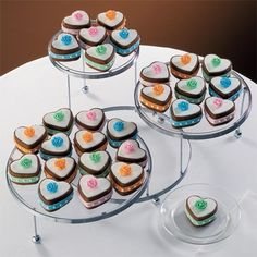 Mini cakes are a wonderful idea for a wedding shower or reception. Change the featured pastels shown here to shades of pink and red and you have a colorful Valentine's Day idea!