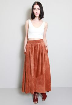 Vintage 1970's Chocolate Brown Suede Flared Midi Skirt. Fastens with a hidden zip at the front. Beautiful detailing with three panels. This skirt would fit UK 8 depending on your preferenceof fit. Please see SIZING & CARE tab for exact measurements. Sizes listed are just an ESTIMATE - as vintage sizes run different than sizing used today. Please pay attention to the measurements given to determine the fit for you. This item is vintage and therefore one of a kind. Although in good vintage…