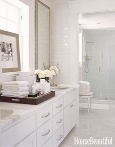 "Designer David Jimenez wanted the bathroom of this Kansas City colonial to feel like a retreat: ""I love the idea of stepping into a bathroom and having it feel like a spa."" Counters and floor tiles are Calacatta Gold marble.   - HouseBeautiful.com"