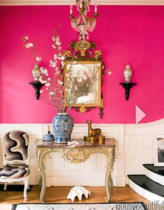 glamourous and unrestrained pink walls and opulent furnishings