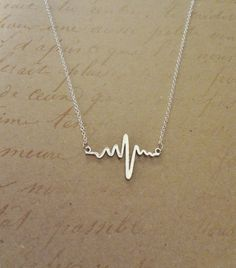 Electrocardiogram EKG Rhythm Heart Beat Necklace- Simplistically Beautiful and a wonderful statement on many levels. Perfect for anyone in the medical field or who appreciates anatomy!
