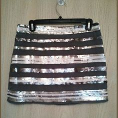 NWT $89 sequin grey skirt New with tags! Very cute grey skirt with sequins striped throughout. Andrew Charles Skirts