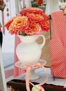 milk glass hobnail pitcher full of flowers