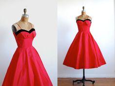 Showstopping 1950's red taffta dress with a sweetheart shelf bust trimmed in black velvet, skinny straps and full swishy skirt!