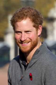Prince Harry smiles as he welcomes six ex-servicemen and women who have travelled the length and breadth of Britain over 72 days since starting the arduous journey in Moray, Scotland, in August, as part of Walking With The Wounded (WWTW) Walk of Britain,