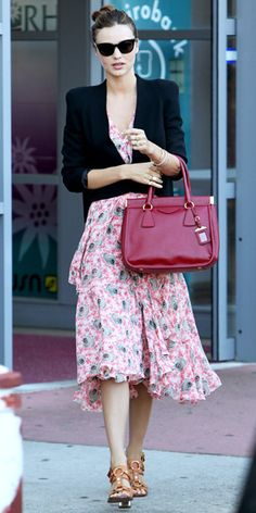 Kerr worked a tiered print dress, relaxed blazer, red Prada satchel and leather sandals in Sydney.
