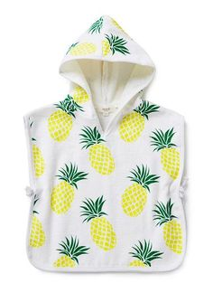 100% Cotton Poncho. Terry towelling hooded poncho with front pouch pocket. Features all over pineapple print with tassle trim. Relaxed fit, available in colour shown.