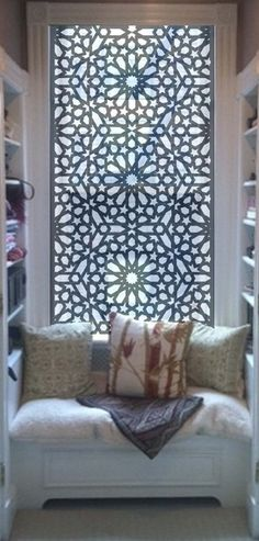 Filigree panel as  window covering. Great way to hide a bad view.