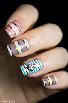 Nautical Stripes. http://www.blingfinger.net/2014/05/nautical-stripes-tape-nail-art.html