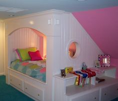 Very cool way to take advantage of a slanted attic wall  --- This would have been so cool in my room at home as a kid.  I would have loved it!