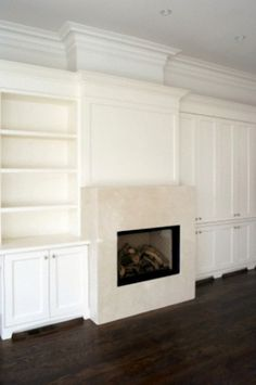 unobtrusive white shelving around fireplace - and the moulding across the top could possibly be a display shelf, too. Probably couldn't use the fireplace very much, all that white would get smudgy!