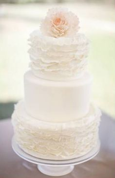 Have last name written in simple cursive on the middle tier in one of the two colors and different topper
