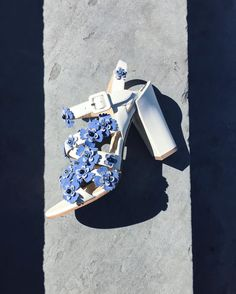 The strappy Ivory nappa #PaulAndrew LOTUS FLORAL sandal adorned with Wedgwood blue suede flowers and a covered buckle by paulandrew