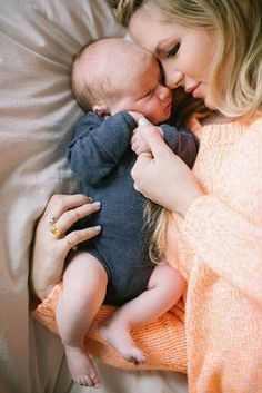 sweet newborn photo cuddling with mom in bed