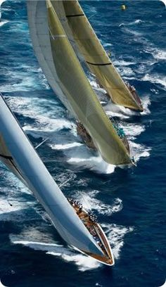 Ranger (J class) on the nearside, the schooner 'Windrose' in the middle sailing close to the the restored Velsheda (J class) upwind at the 2004 Antigua Classic Yacht Race...