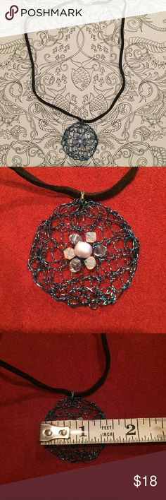"Twisted Wire Swarovski Crystal Pendent Necklace Handmade from beautiful colored wire and Swarovski crystals, this necklace is one of a kind! I use colored wire to knit my creations into beautiful jewelry that go with any occasion or with Lilly Pulitzer!   This necklace features blue wire with light blue and opal pink Swarovski crystals. Pendent measures 1 1/2"""" in diameter, necklace is 16"".   Please see my closet for other designs! Price is firm, as these are handmade by me. I have a 15%…"