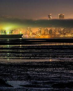 """Dead Low . This morning's dreadfully low tide (0.7 ft) seemed to empty English Bay. Fog rolled in and was lit green by the lights on a container ship anchored in the bay. As I was shooting a """"four-legged"""" ran in front of me on one of the sandbars (probably a coyote looking for a fish dinner ) Captured from the Spanish Banks in Vancouver British Columbia Canada December 6 2017 . . . . . #Fogcouver #Vancouver @Vancouver_Canada #VeryVancouver #VisitaVancouver #CuriocityVan #VancityFeature…"""