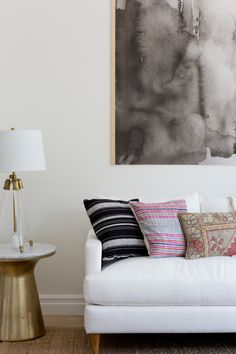 White linen sofa and color pop throw pillows: http://www.stylemepretty.com/living/2016/09/16/see-how-a-party-stylist-translates-her-cool-girl-style-into-her-home-x2/ Photography: Amy Bartlam - http://www.amybartlam.com/
