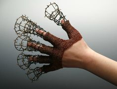 Damia Smith  Defense Mechanism  This crocheted glove form which ends in spiked cones is wearable but not pleasant to be worn.  It protects and causes pain for the wearer at the same time.