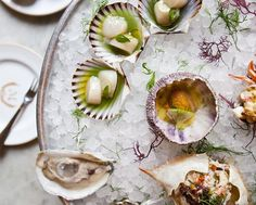 Happy hour at Maison Première in Williamsburg features oysters & absinthe, served in a France-meets-New Orleans setting.
