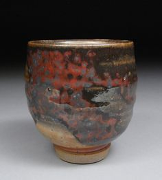 Yunomi Tea Cup glazed with Shino, Wood Ash and Copper Great Carbon Trapping. $38.00, via Etsy.