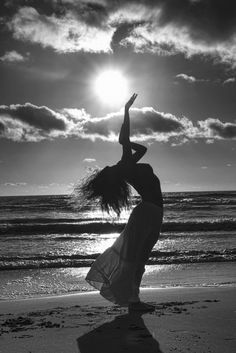 Beautiful topless free-spirit in silhouette ... Sun salutation, greeting the day ...