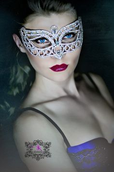 She is a mystery.....Mask, crystals, makeup, amazing, gorgeous, beauty.