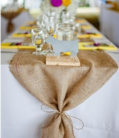 burlap table runner what if we tied the green runner and peacock feather in to this??