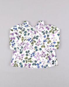 Blusa de flores con vuelo marca Benetton http://www.quiquilo.es/catalogo-ropa-segunda-mano/blusa-de-flores-con-vuelo-en-color-violeta-marca-benetton.html