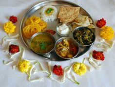 Maharashtrian Thali : Chapati, puran Poli (sweet chapati),  White rice, Amti Kadhi with drumsticks (spicy daal), methi sabzi (chopped fenugreek leaf curry), aloo matar (potato and peas curry), roasted papad, curd (plain yogurt), spicy pickle (loncha, achar), jalebi sweets.